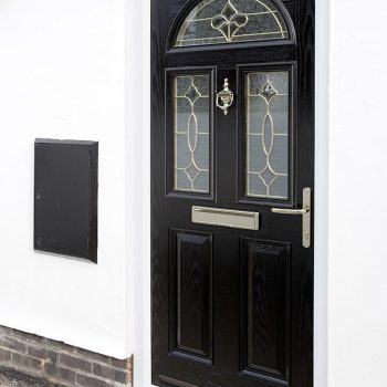 Black composite door with gold leading
