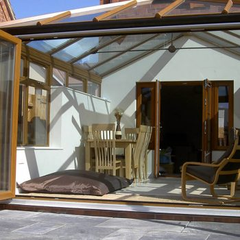 Open golden oak uPVC bifold door