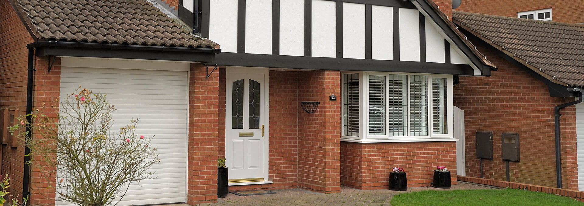 White uPVC bay window and entrance door