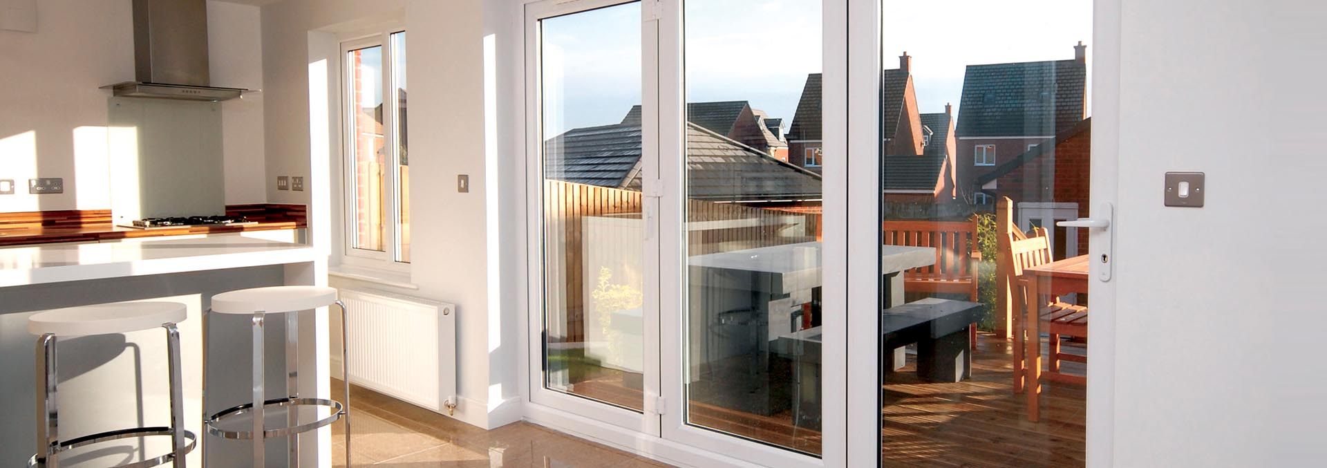 White uPVC bi-folding door with three panes
