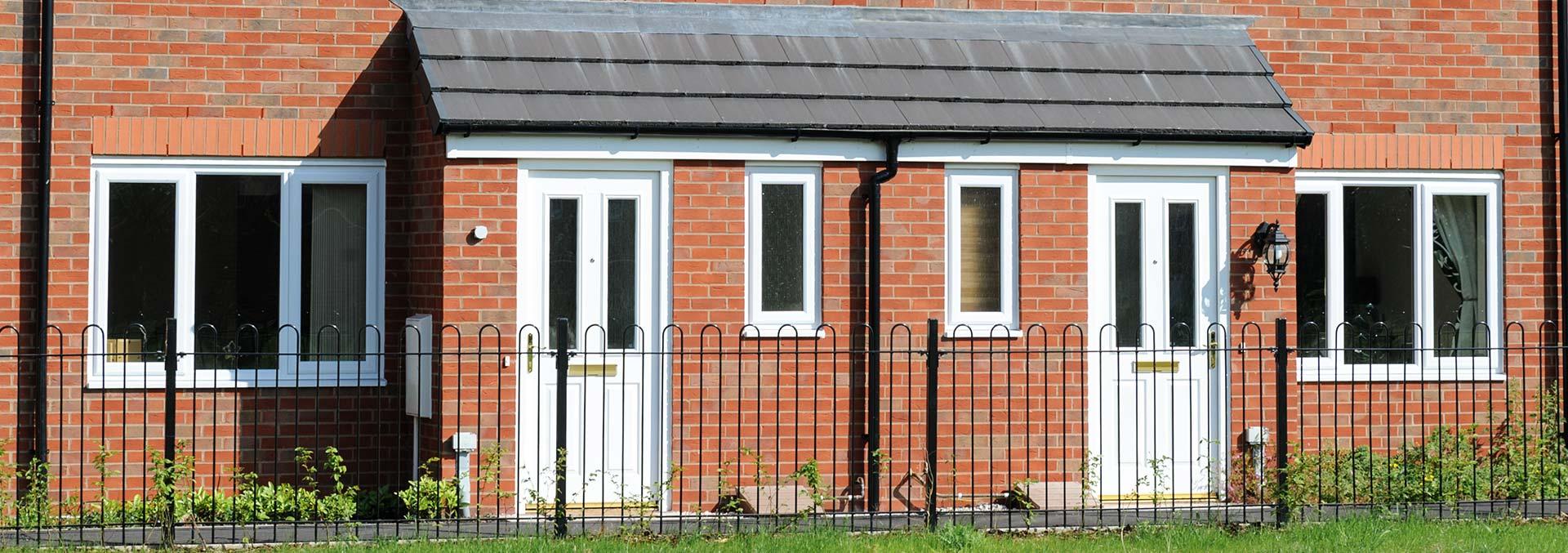 Brick porch with white entrance door