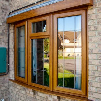 Brown bay window replacement double glazing and lead detail