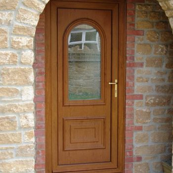 Brown uPVC entrance door with arched glass