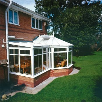 Custom p-shape conservatory in white