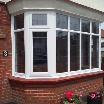 Large white uPVC bay style window with lattice lead detailing