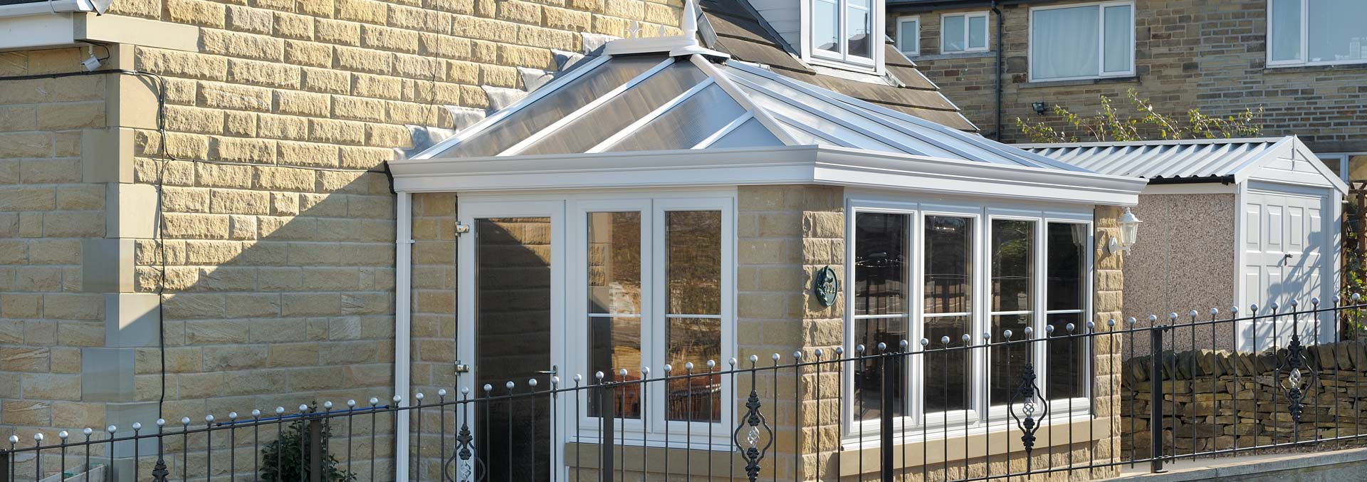 Orangery build with brick structure and uPVC windows, doors and roof