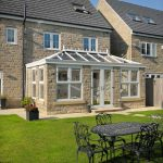 Orangery installation with brick structure and pvcu roof, windows and doors
