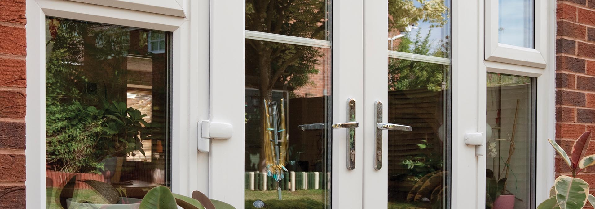 Patio french doors smiths glass white upvc french doors with astragal bars for a traditional look rubansaba