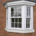 White uPVC vertical sliding Georgian window