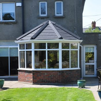Grey tiled warmroof on a uPVC victorian conservatory