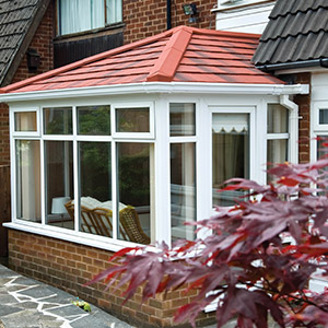 Conservatory with a red tiled roof
