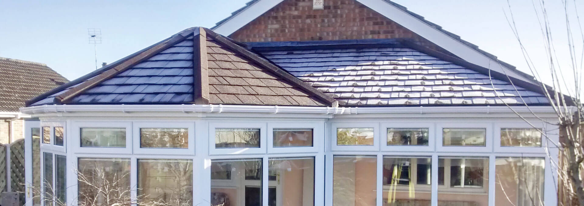 P shape conservatory with tiled roof system