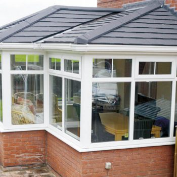 Conservatory with tiled roof, brick base and uPVC windows and doors